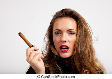 women with red lips inhales while holding a cigar