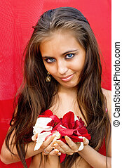 women with rose petals on red