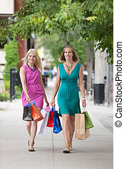 Women With Shopping Bags On Sidewalk
