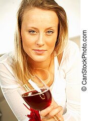 Pretty young blonde women with glass of red wine
