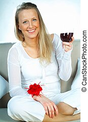 Women with wine - Pretty young blonde women with glass of...