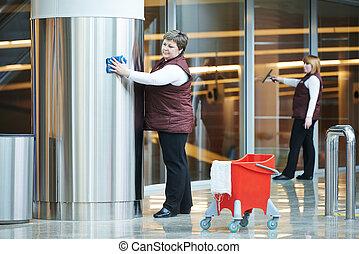 women workers cleaning indoor interior