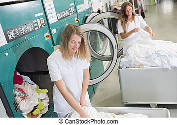 women working at an industrial laundry