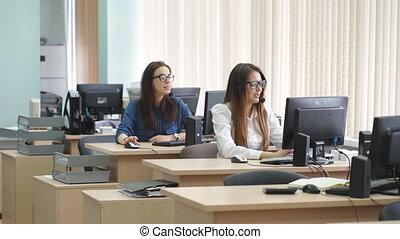 Women working in a call center with customers