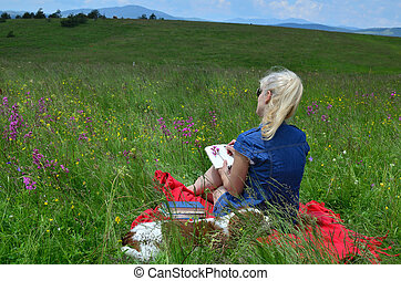 Women Writing in a Notepad on a Meadow