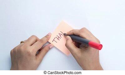 women' writing thank you note , top down - women's hand ...