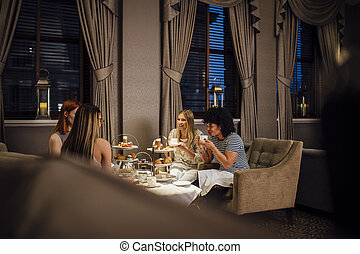 Women's Afternoon Tea - Four women are sitting together ...