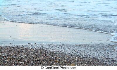 women's beautiful tanned legs walking on sand at beach. Girl...