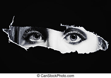 Women's blue eyes spying - Women's bl eyes spying through a...