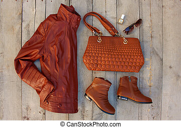 Women's clothing and accessories on old wooden background. Top view. Flat lay.