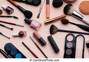 Women's cosmetics and makeup set on pink background. Top view