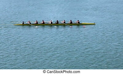 Womens Crew Team Rowing On Lake Pan - Panned Shot Of Womens...