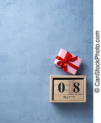 Womens day concept with wooden calendar on blue background