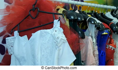 Women's dresses hanging on a hanger in the wardrobe. -...