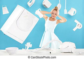 Women's duties - cooking , washing, - Young housewife...