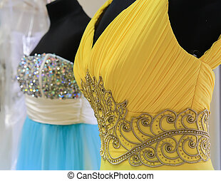 dresses on mannequins in a shop closeup