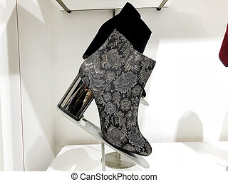 Women's fashion boots in the store on the shelf