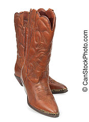 Women's fashion boots. Ladies vintage leather cowboy shoes. Isolated on a white background, close-up.