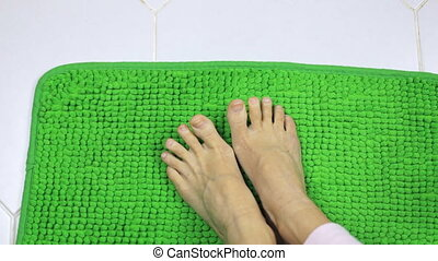 Women's feet are moving on a shaggy carpet - Women's feet...