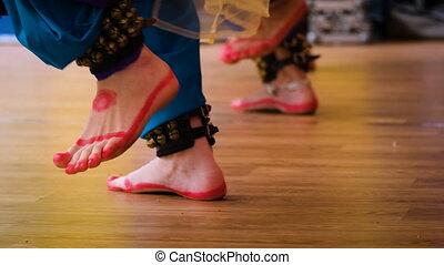 women's feet dancing - Indian dance. women's feet in Indian...