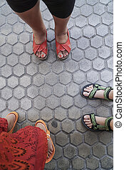 women's feet in sandals