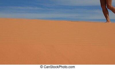 Women's feet walking on a sandy dunes - Barefoot women's...