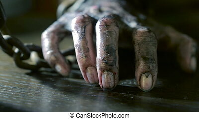Women's fingers with dirty fingernails and burned skin....