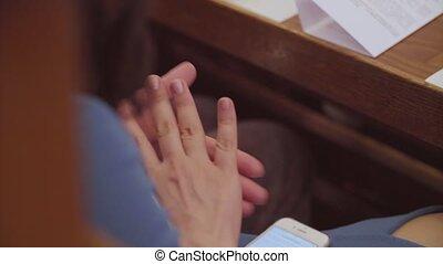 Women's hands applauding speaker