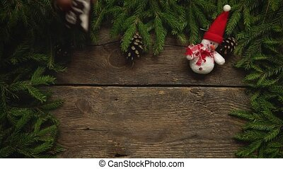 Women's hands create a Christmas decor. Christmas tree...