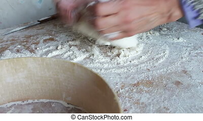 Women's hands knead the dough on a home kitchen.Full HD 1920...