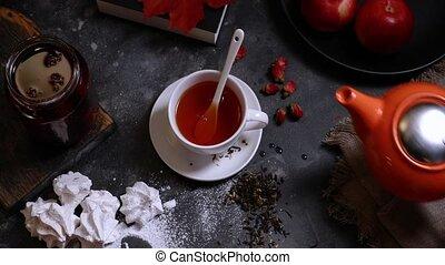 woman drinking tea in autumn decoration