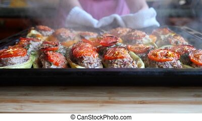 women's hands, stuffed zucchini. hot, freshly baked, stuffed...