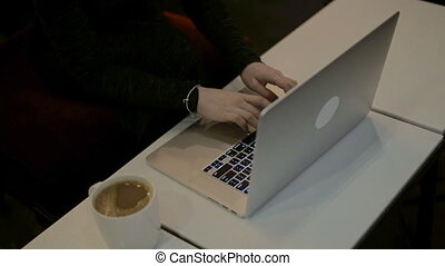 Women's hands typing on computer keyboard