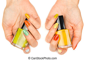 Women's hands with a colored nail varnish. Isolated on white background
