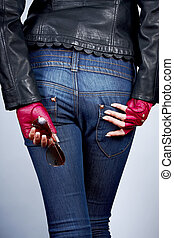 Women's hands with the sunglasses in stylish gloves