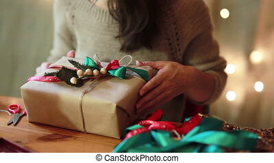 Women's Hands Wrapping Christmas Gifts At Home - Young Woman...