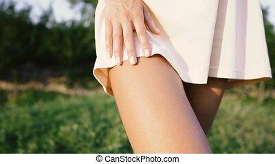 Women's legs. Female tanned legs