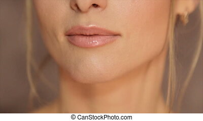 Women's lips, painted with light pomade - Women's lips,...