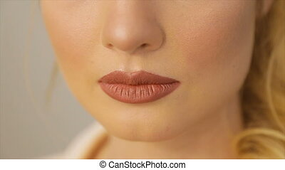 Women's lips painted with red lipstick - Lips of the model...