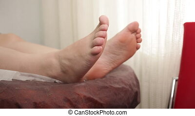 Fingers on the leg are compressed. - Women's rough feet on ...