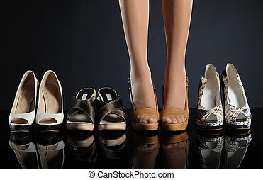 Women's shoes on dark background
