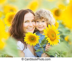 Womn and child in sunflower field