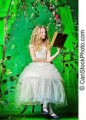 wonder land - Lovely girl in a lush white dress sitting at...