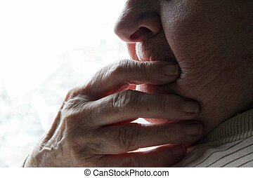 Wonder - Hand over mouth of elderly woman wondering