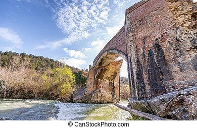 Wonderful ancient bridge over a creek