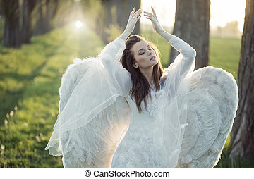 Wonderful angel dancing in the forest