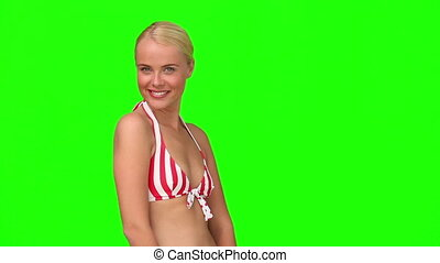 Wonderful blond female in swimsuit looking at the camera
