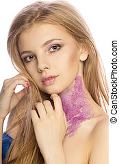 Wonderful blonde model with glitter makeup posing at studio over a white background