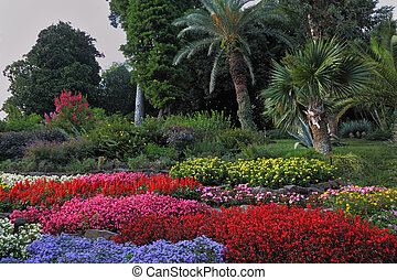 Wonderful bright flowerbeds in an exotic park. Lake Como, ...