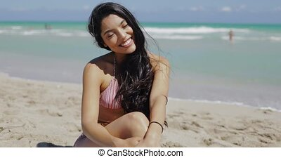 Wonderful coquettish girl on beach - Content pretty woman...